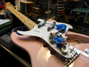 This poor pink Strat got one hell of a workout.