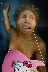 This sculpture of an early hominid from the Museum of Human Evolution in Burgos, Spain, has nothing to do with the fully modern homo sapiens who decorated the caves. Furthermore, recent research calls into question the historical accuracy for her guitar. Some scholars even suspect that it may have been Photoshopped into this photo.